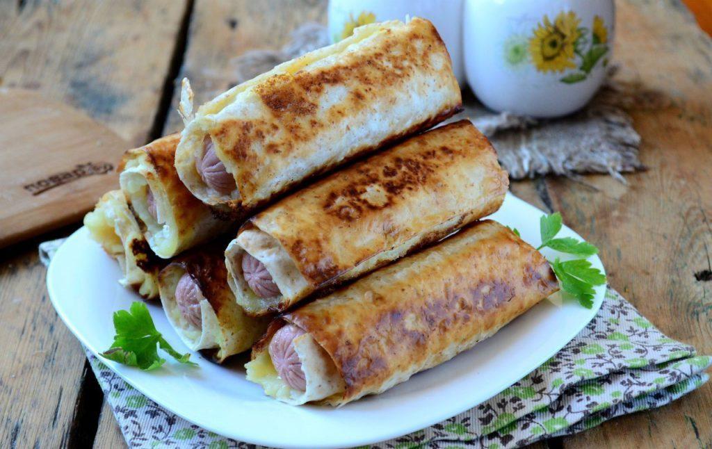 Сосиски в картофельно-сырной шубке